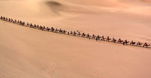 Tourists Try Camel Riding at Mingsha Hill Desert - All China
