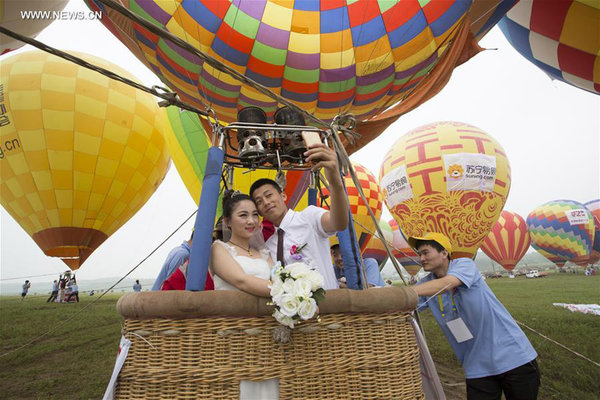 A Newlywed Takes Hot Air Balloon During Group Wedding Ceremony In Nanjing Capital Of East China S Jiangsu Province June 10 2016