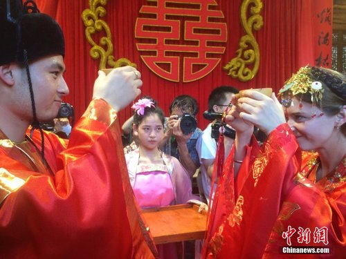 A Young Couple Niu Zhen From China And Mary Ukraine Held Traditional Chinese Wedding Ceremony To Celebrate Their Transnational Marriage