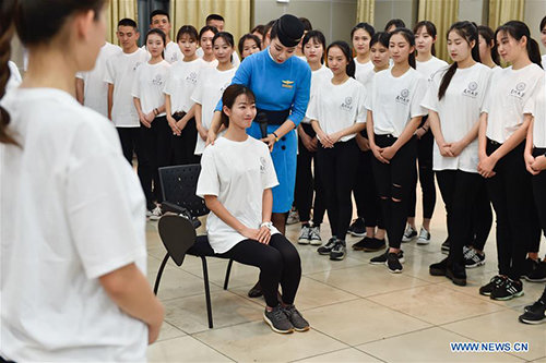 Volunteers for 2017 BRICS Summit Attend Etiquette Training in SE China
