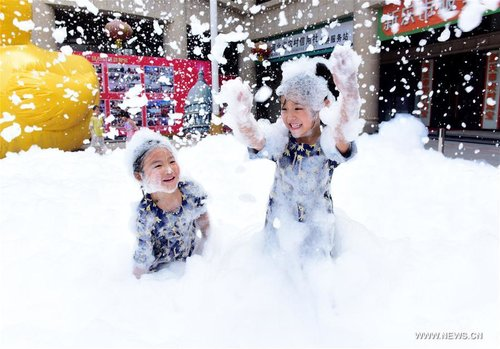 Children Play During Bubble Fair in N China