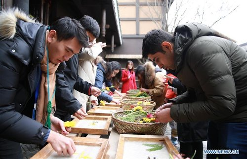 Overseas Students Experience Chinese Intangible Cultural Heritages in Guizhou