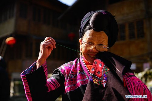 Elderly Woman Makes Traditional Clothes of Yao Ethnic Group