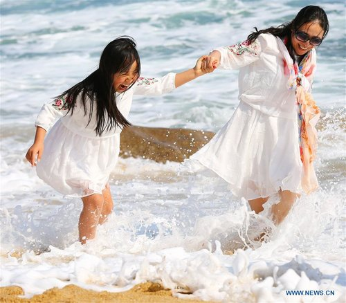 Tourists Have Fun by Seaside in Sanya, S China