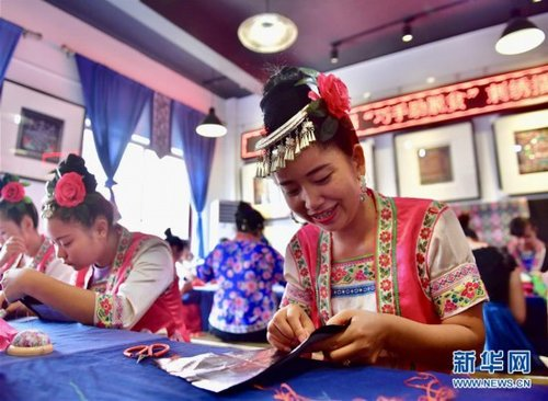 County Women Compete in Ethnic Sewing Skills Contest