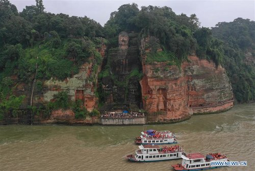 People View Statue of Leshan Giant Buddha in SW China's Sichuan