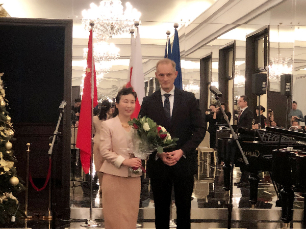Chinese Writer Honored with Bene Merito Distinction Award