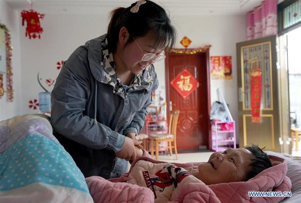 Pic story of young villager taking care of disabled mother in Lianyungang, E China